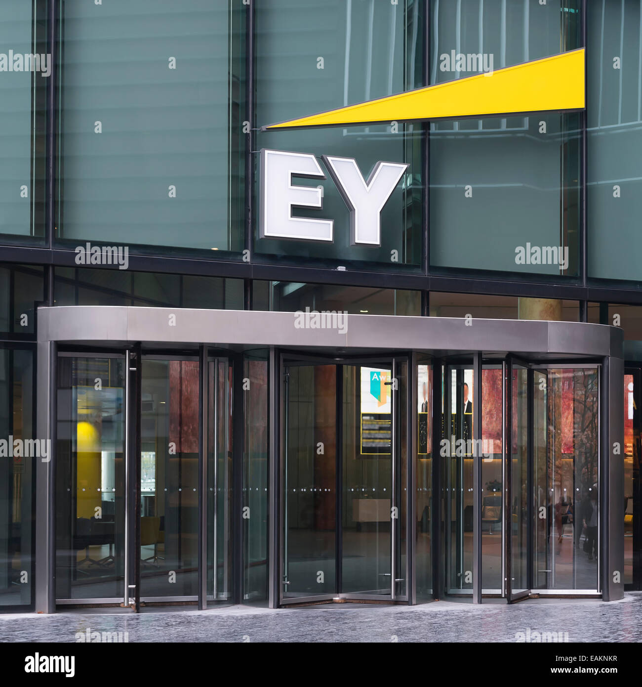 Front door of the offices of EY, Ernst and Young, at More London with their logo above - Stock Image