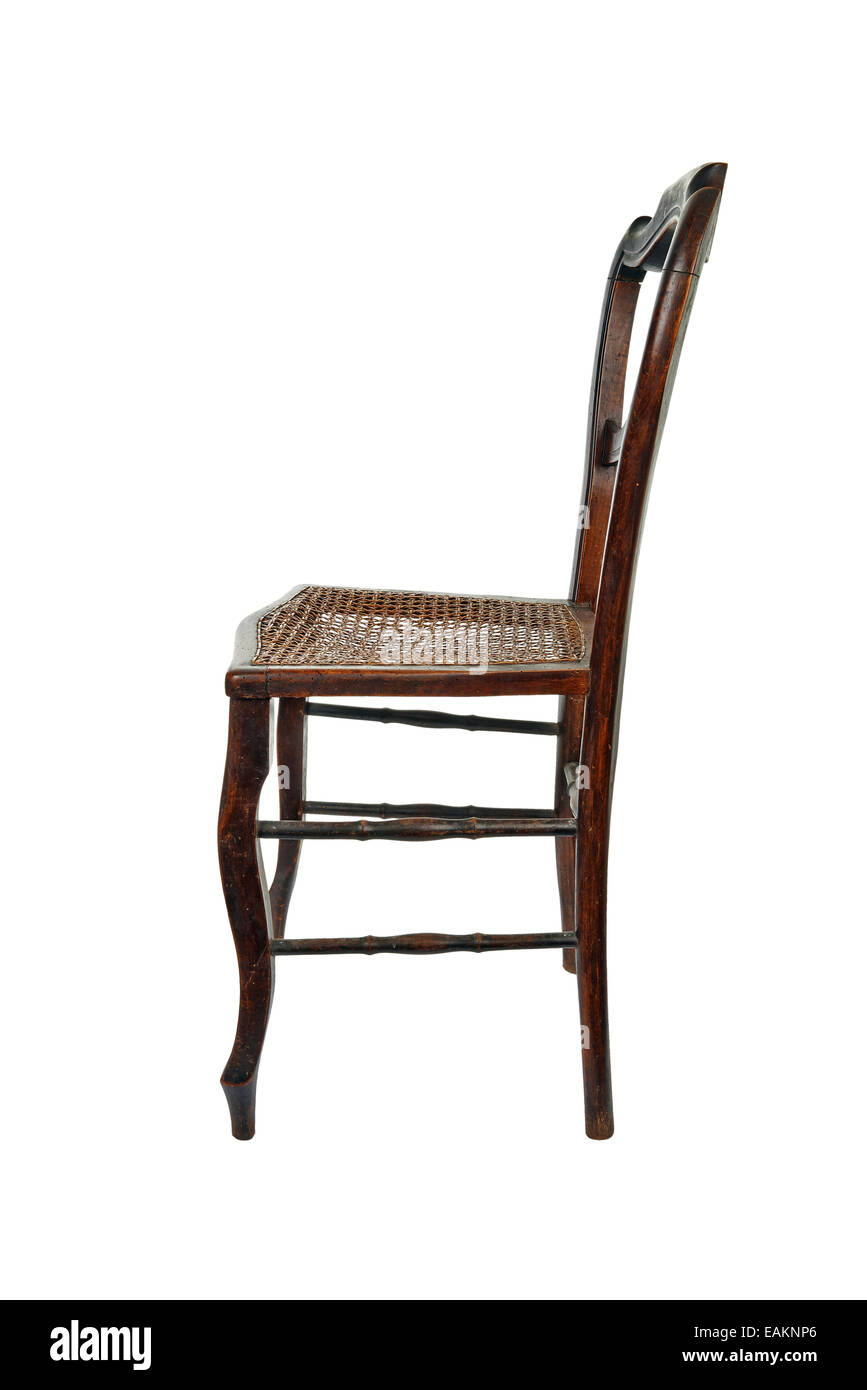 Antique wooden chair with cane isolated on white - side view - Antique Wooden Chair With Cane Isolated On White - Side View Stock
