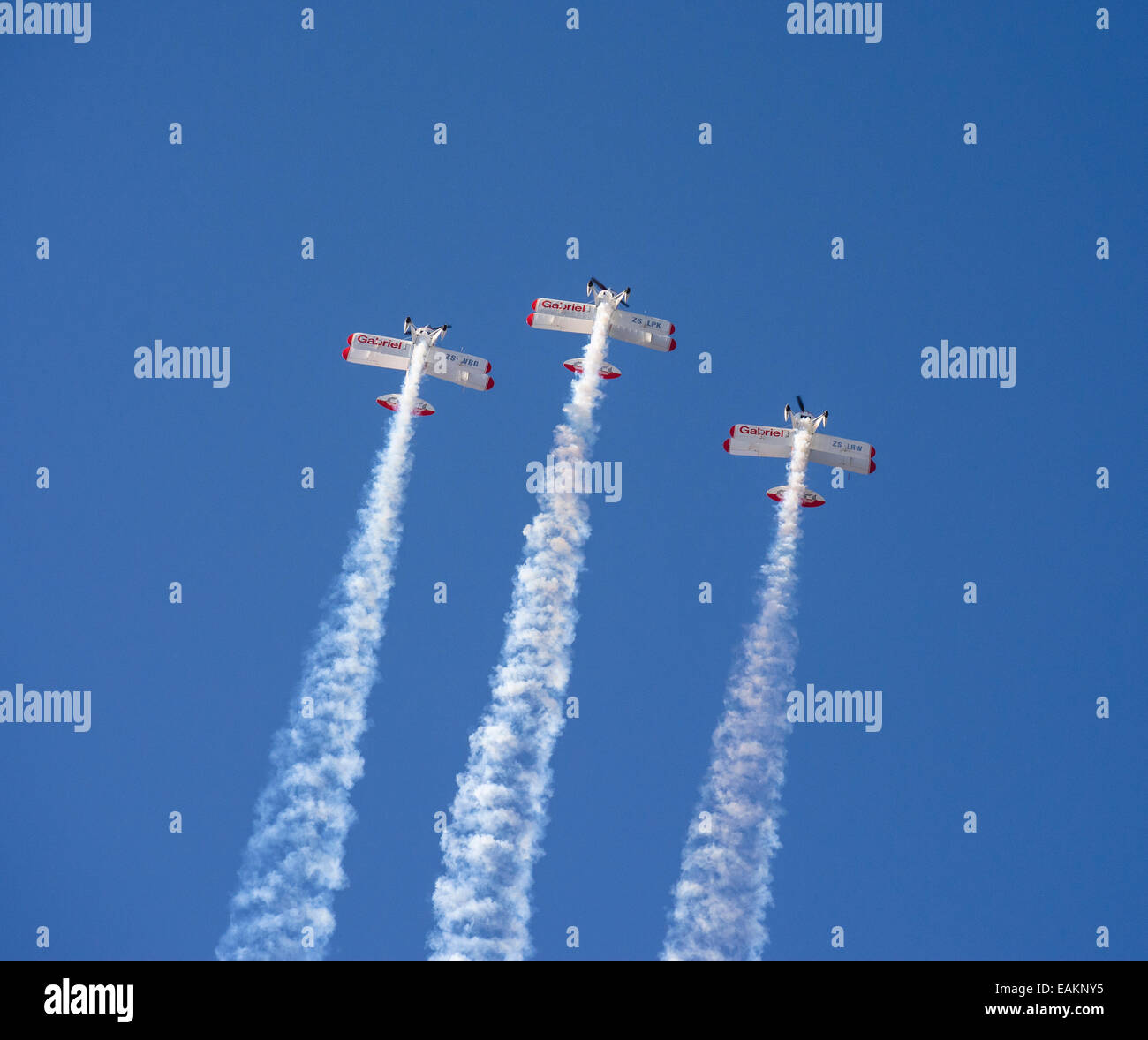 Three aircraft flying vertically upwards during a demonstration at the Lowveld Air Show - Stock Image