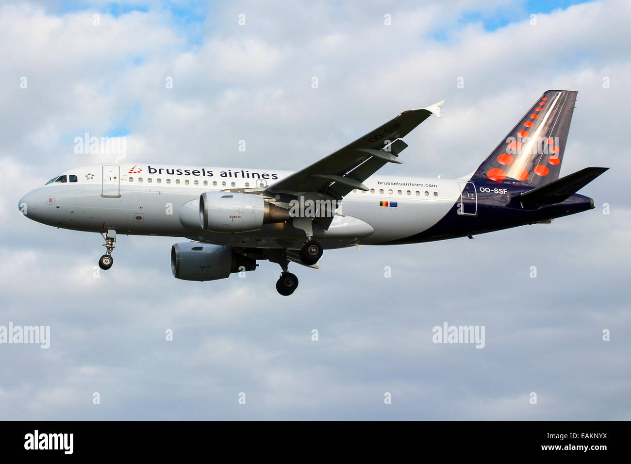 Brussels Airlines Airbus A319 approaches runway 27L at London Heathrow Airport. - Stock Image