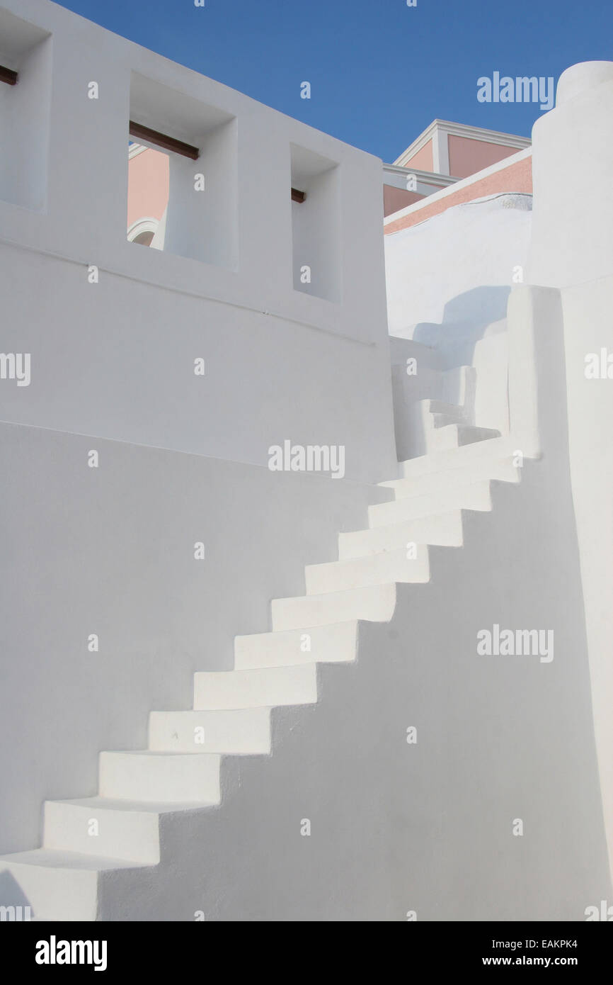 Minimal White Stone Staircase Between Two White Walls With Rooftops