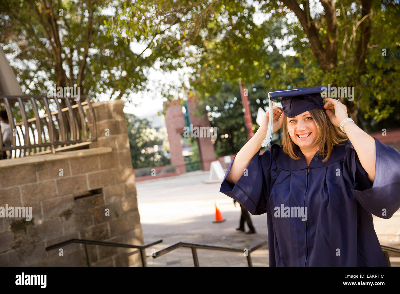 Graduates with caps and gowns before their graduation ceremony from WGU Texas and online university - Stock Image