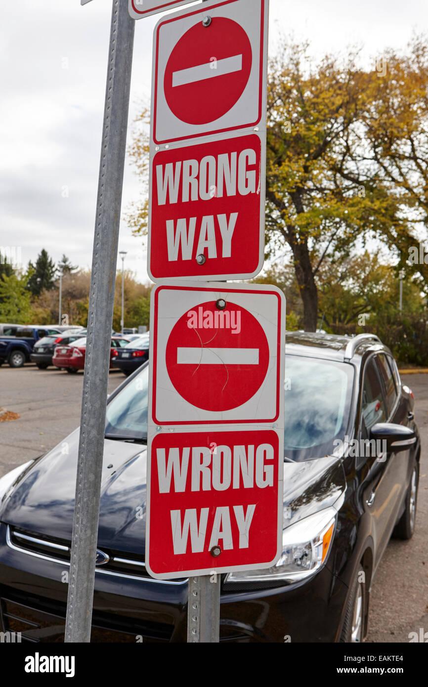 wrong way no entry sign with car behind Saskatchewan Canada - Stock Image