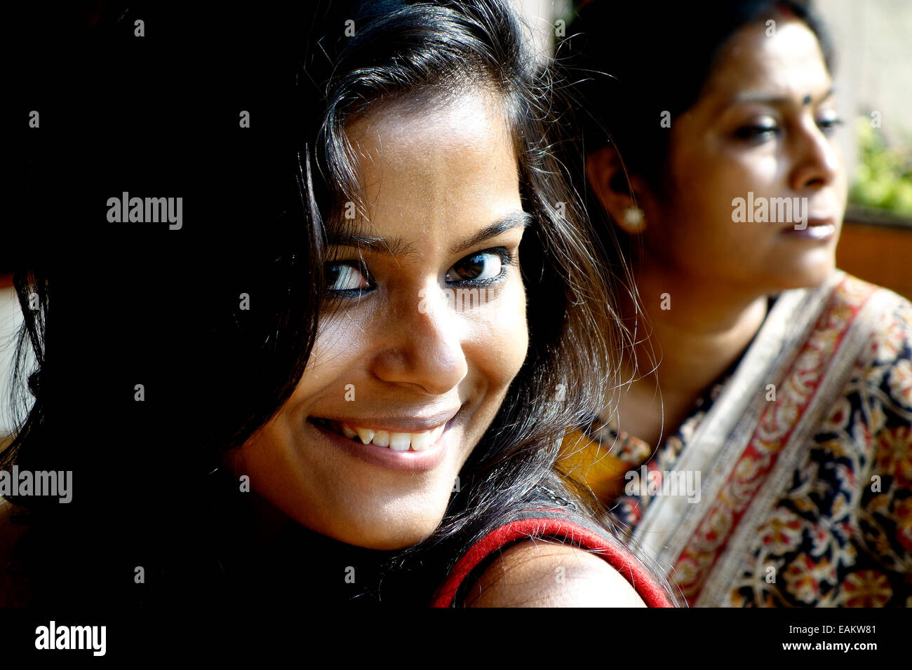 women,beautiful,big eyes,Bengali,Indian,sultry,smiling,attractive,ladies,family - Stock Image