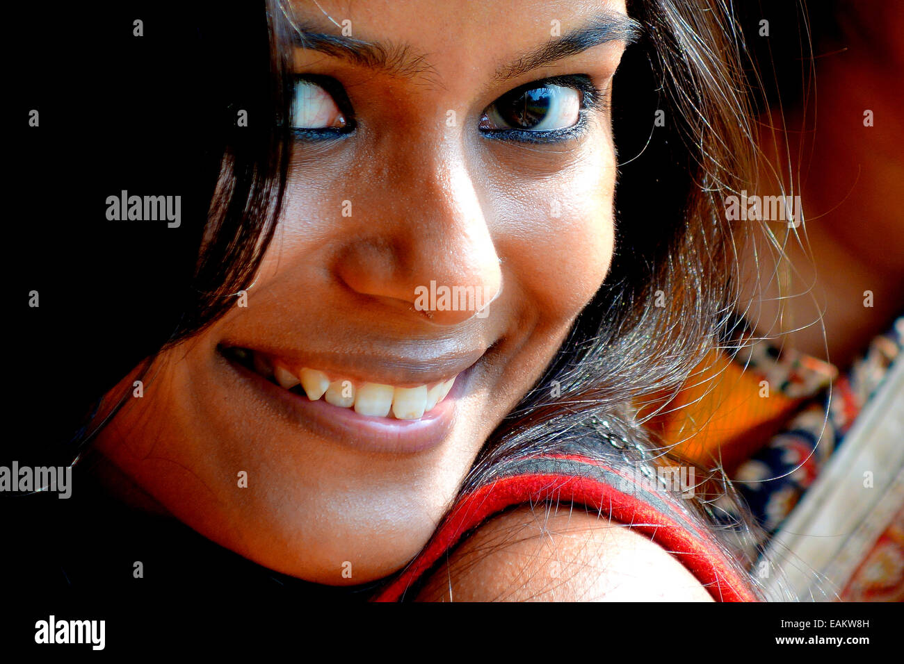 young,girl,beautiful,big eyes,Bengali,Indian,woman,sultry,smiling,attractive - Stock Image