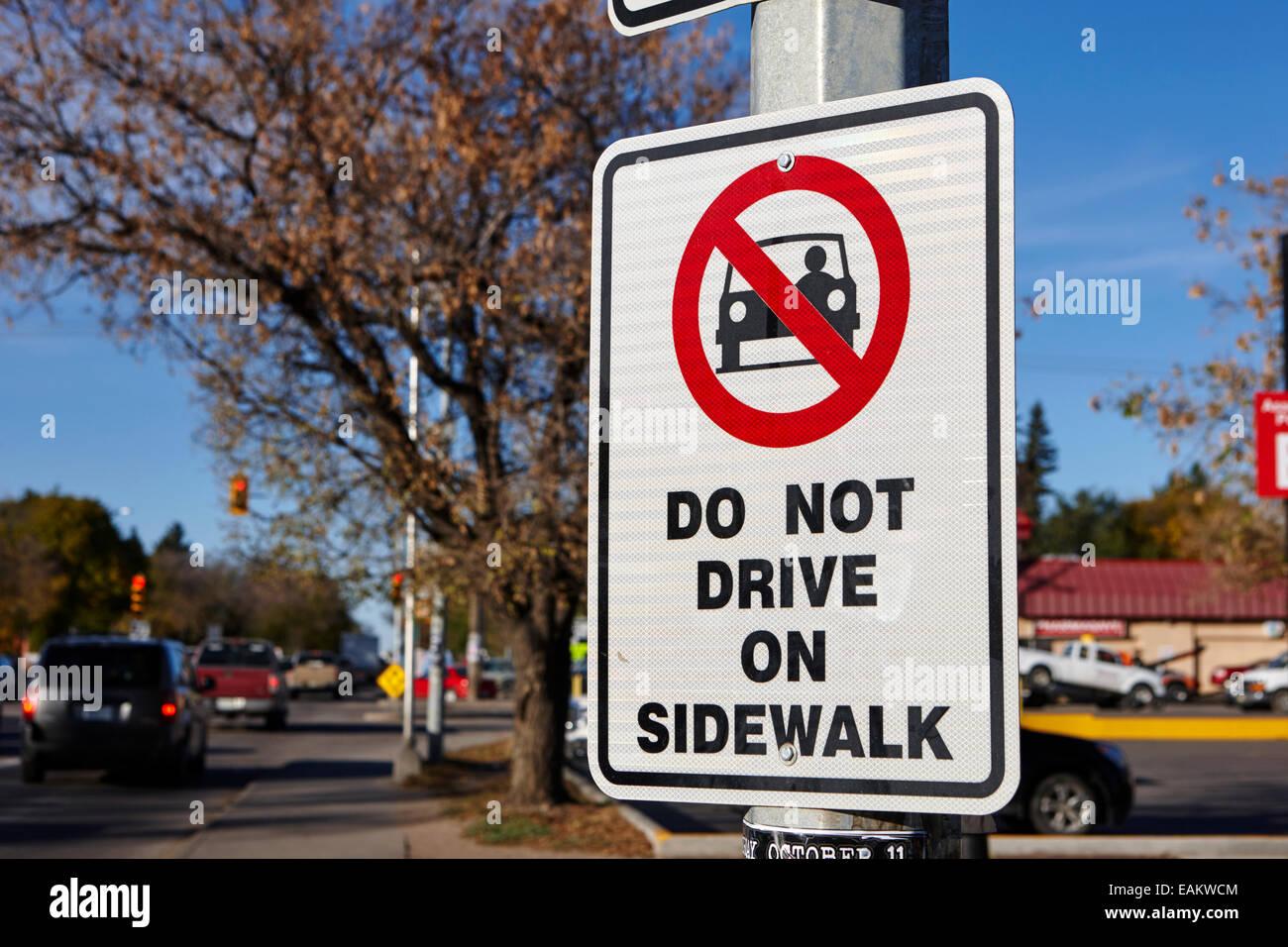 do not drive on sidewalk sign saskatoon Saskatchewan Canada - Stock Image