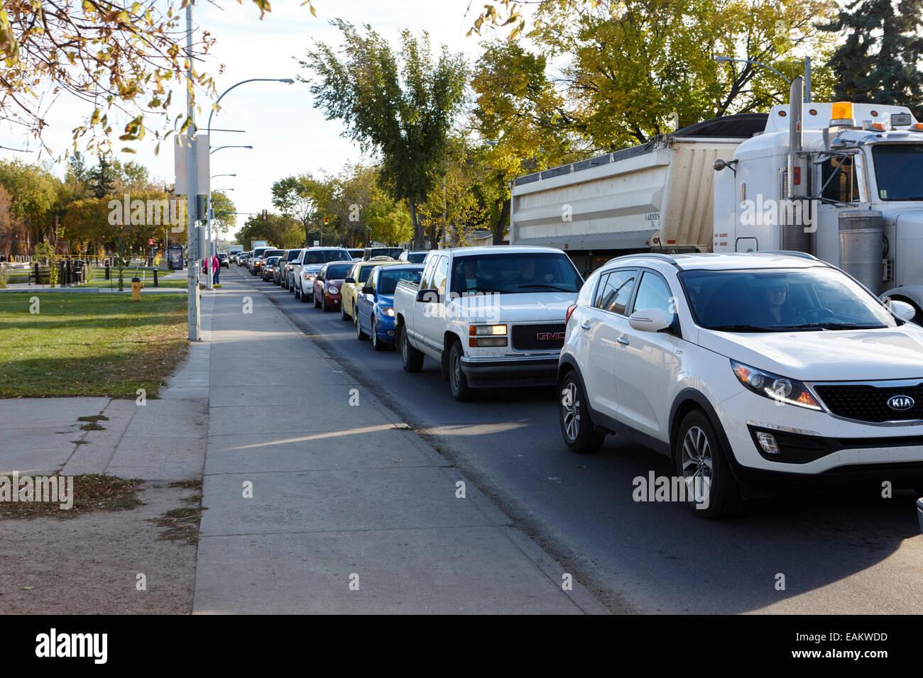 traffic building up in street at rush hour saskatoon Saskatchewan Canada - Stock Image