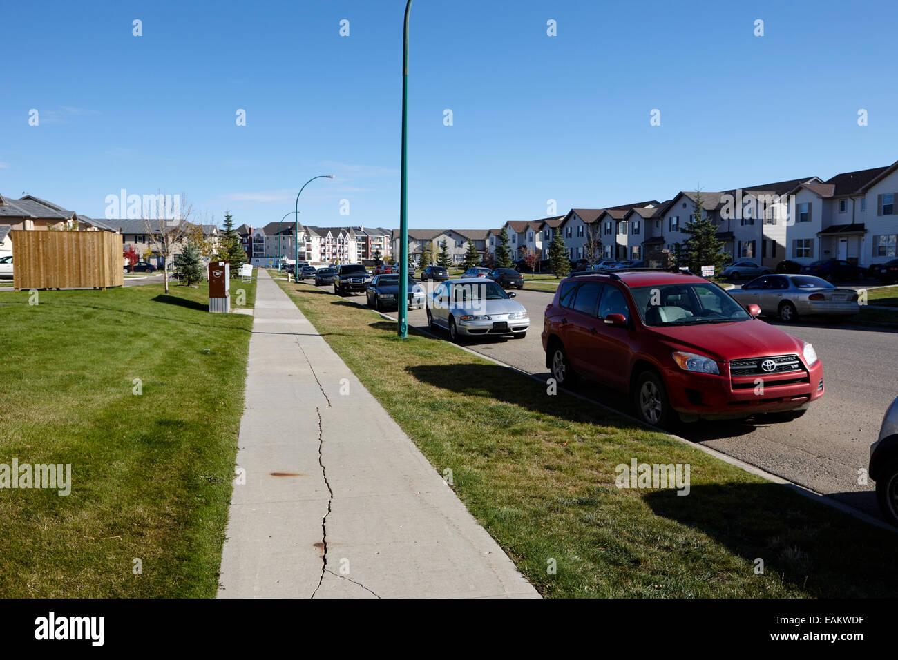 empty sidewalk in quiet suburban neighbourhood saskatoon Saskatchewan Canada - Stock Image