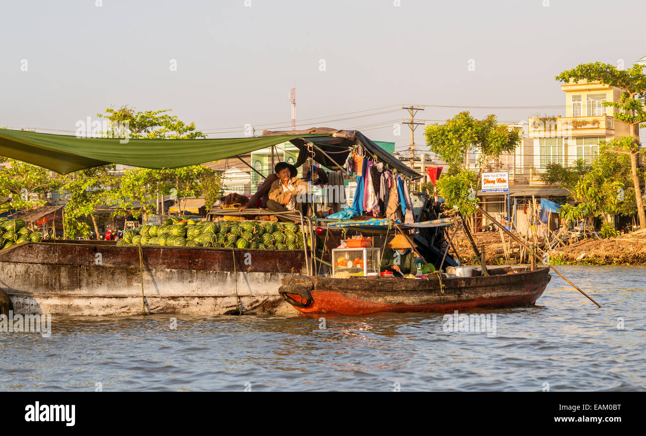 The floating market of Phong Dien on the Hua River in the Mekong Delta of Vietnam. Stock Photo
