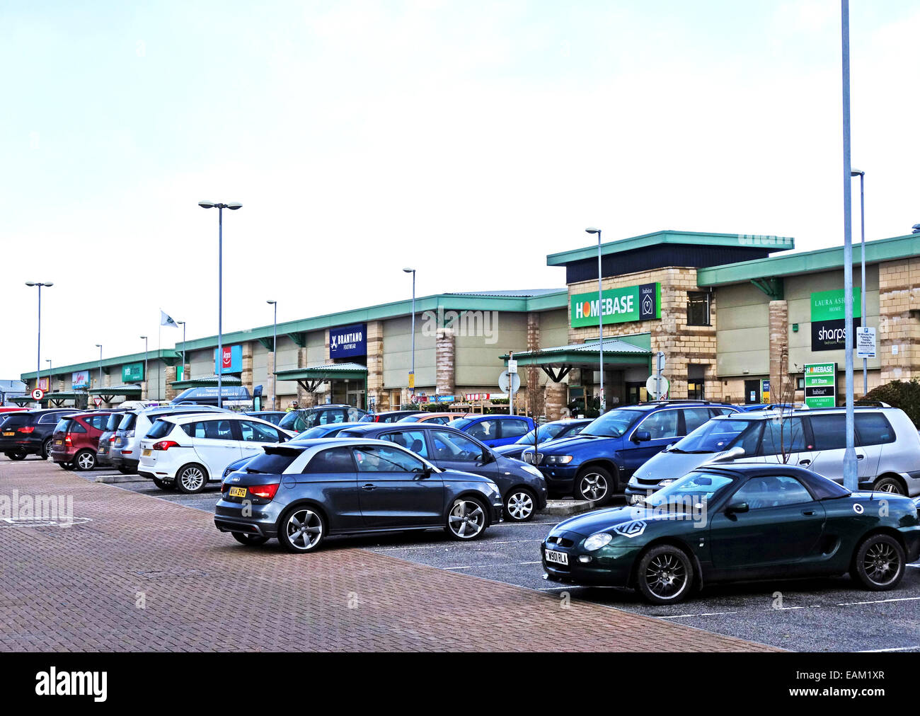 Cars parked at an out of town retail park - Stock Image