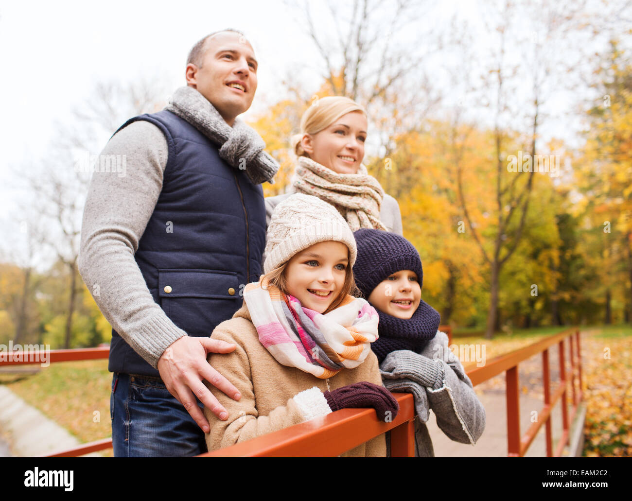 happy family in autumn park - Stock Image