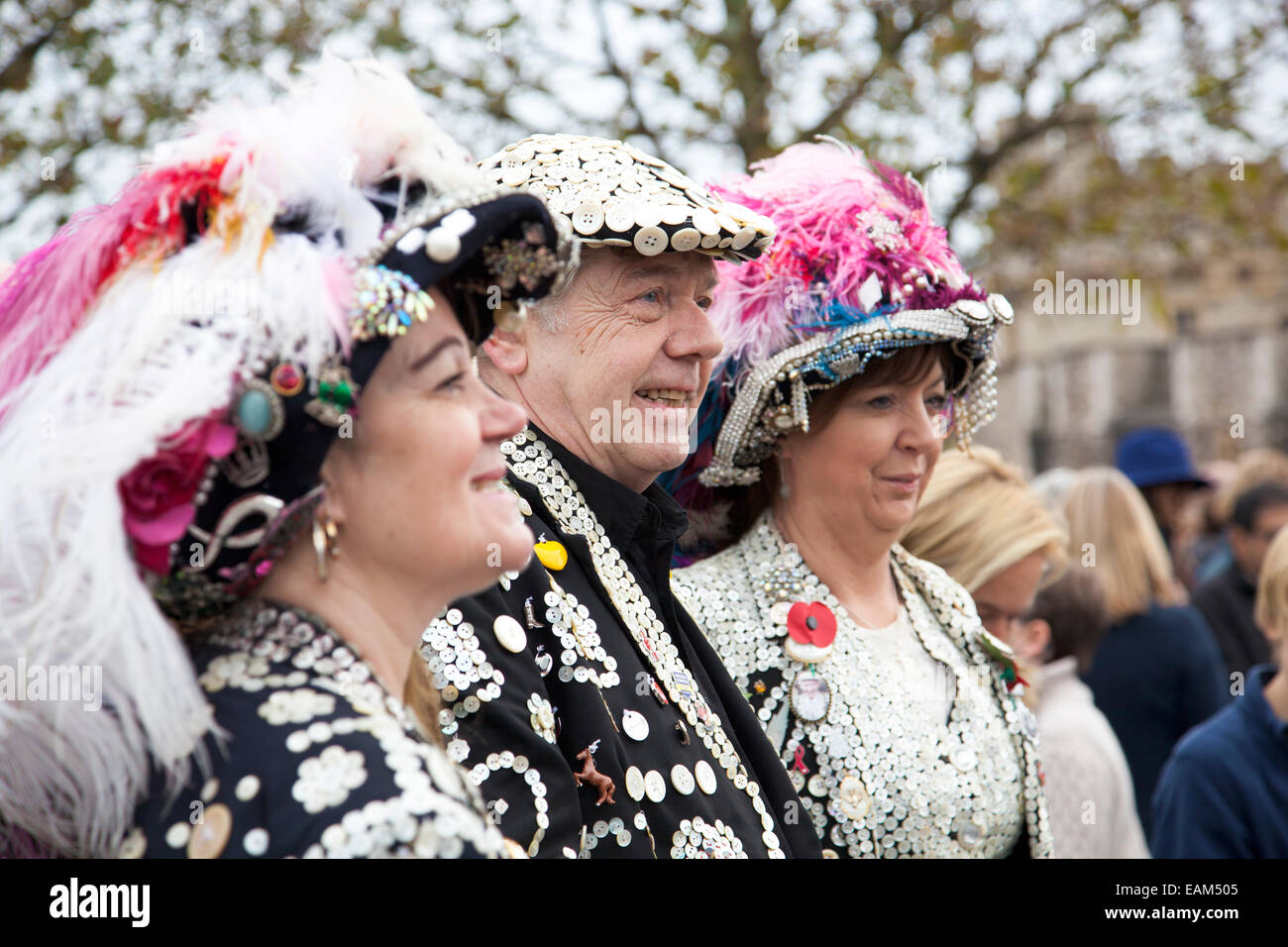 Pearly Kings and Queens by the Tower of London during the Blood Swept Lands and Seas of Red poppy installation 09 - Stock Image