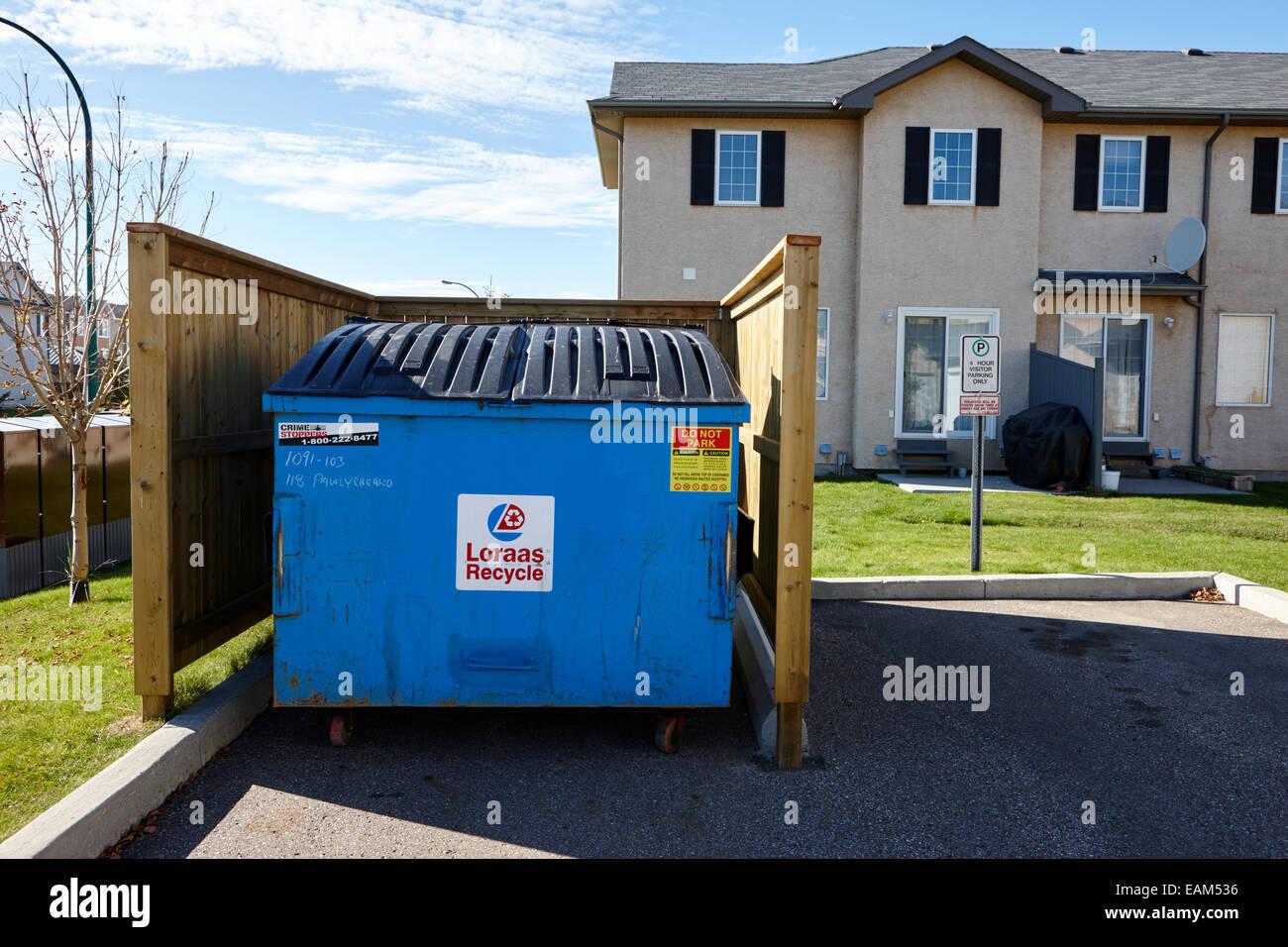 communal recycling bin in suburban neighbourhood saskatoon Saskatchewan Canada - Stock Image