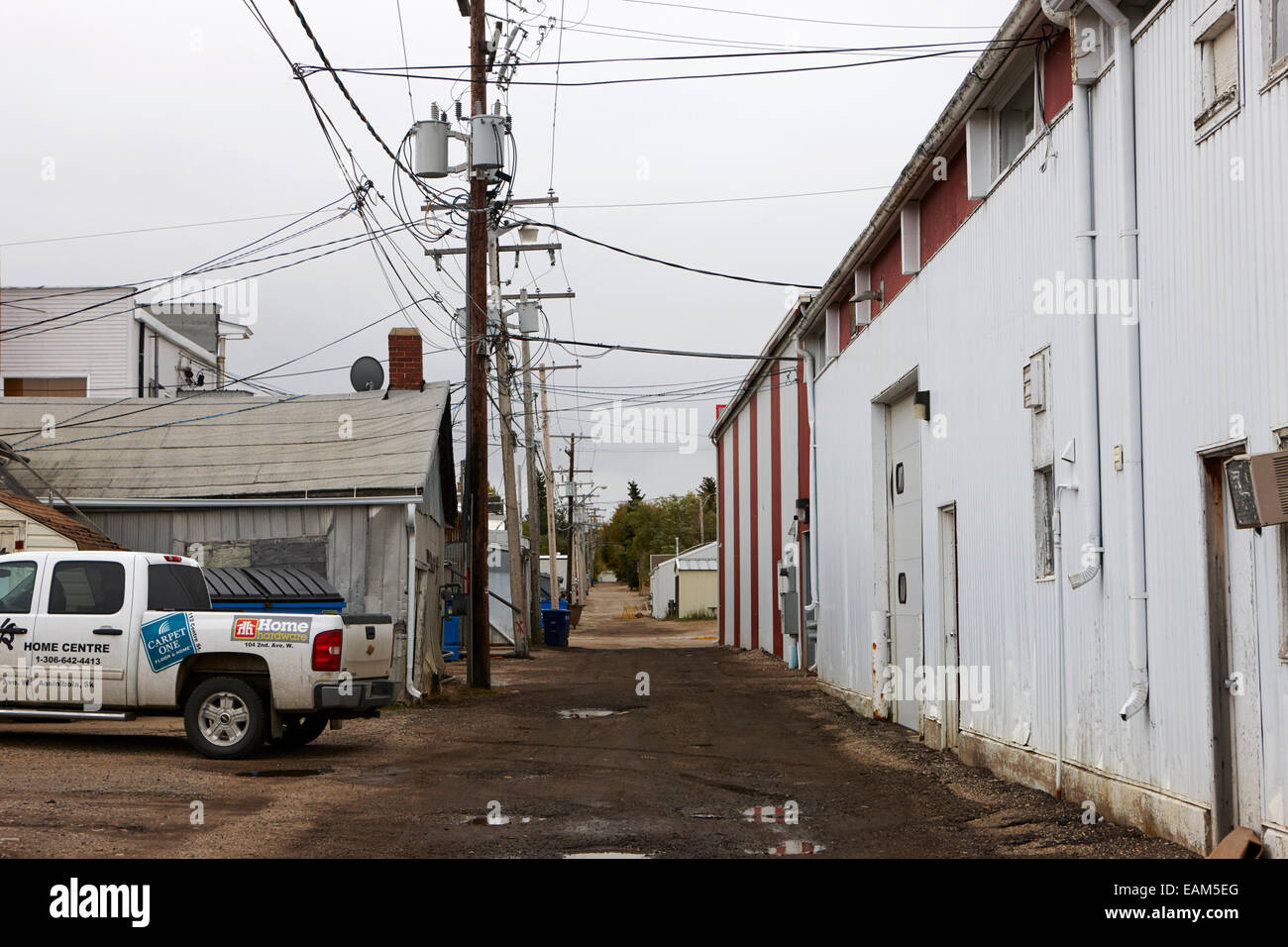 service alley at the rear of commercial premises Saskatchewan Canada Stock Photo