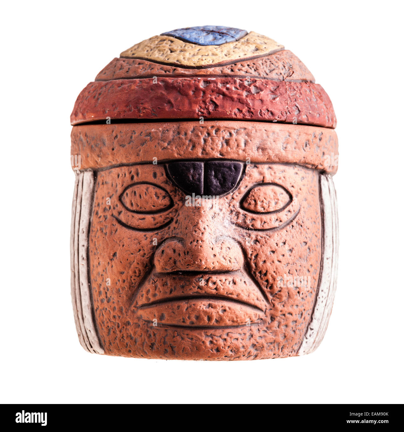 a terracotta olmec face idol souvenir isolated over a white background Stock Photo