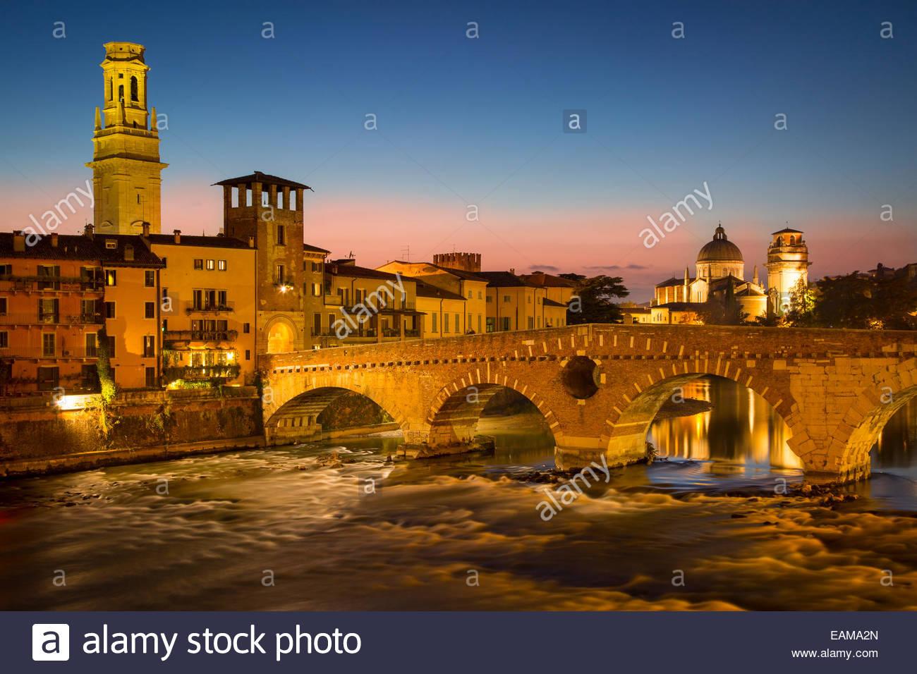 Ponte Pietra over River Adige with Cathedral Anastasia and the skyline of Verona beyond, Veneto, Italy - Stock Image