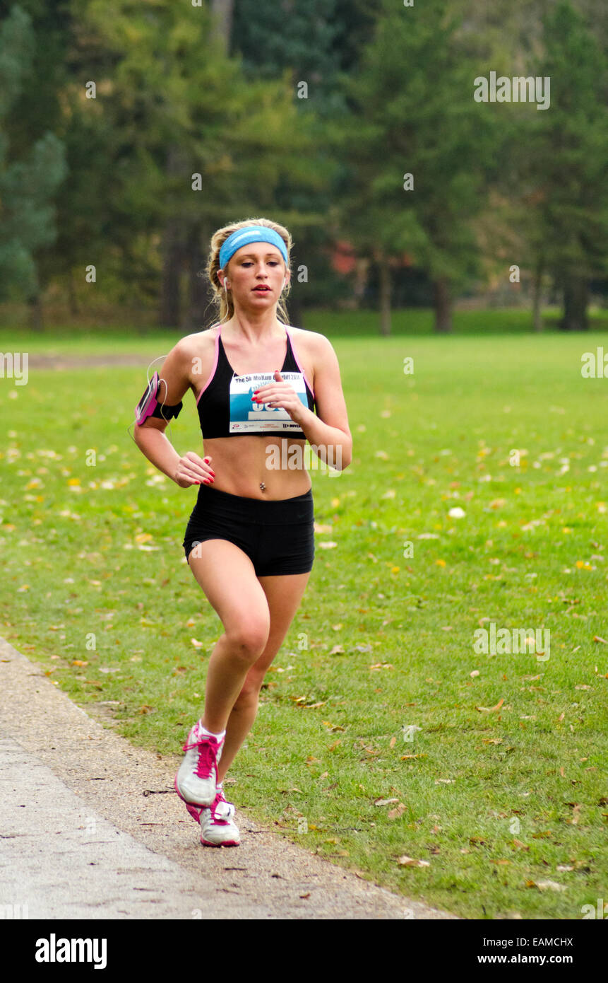 Female runner at the Cardiff 5k Morun, Cardiff 2014, part of Movember mens health fundraising events - Stock Image