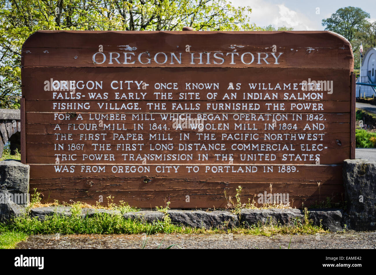 wooden historical marker sign with history of oregon city oregon