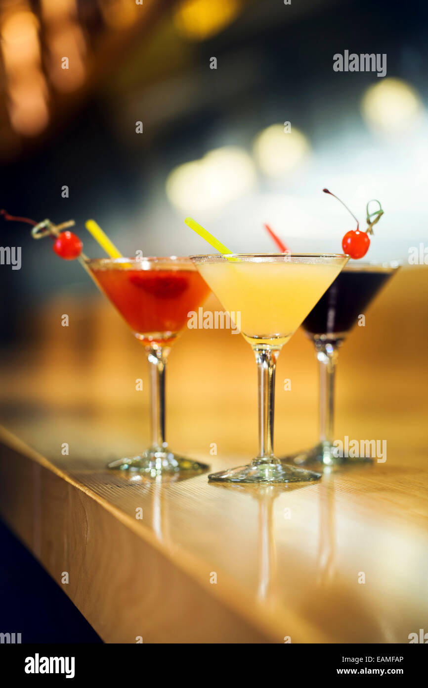 Cocktails on a bar - Stock Image