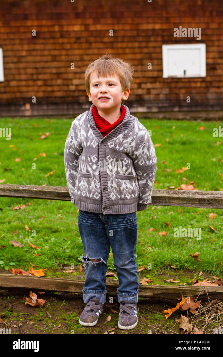 Three year old boy in a lifestyle portrait showing the child outdoors. Stock Photo