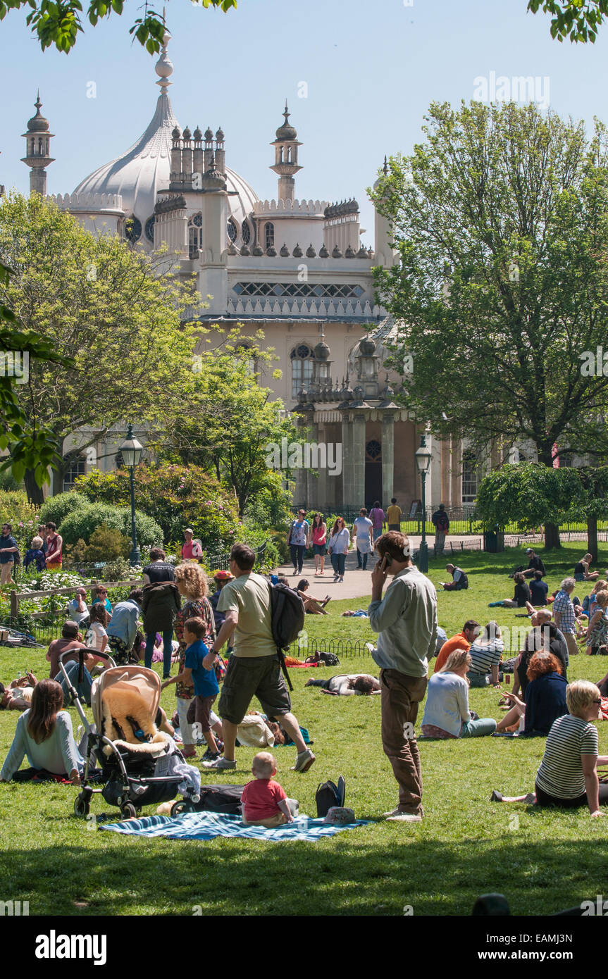 Families enjoying the summer in the Royal Pavilion gardens  Brighton Sussex  England UK - Stock Image