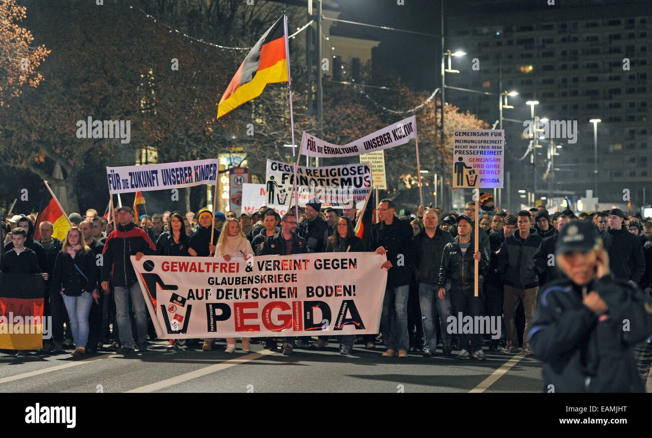 Dresden, Germany. 17th Nov, 2014. People march with a banner reading 'nonviolent and united against religious - Stock Image