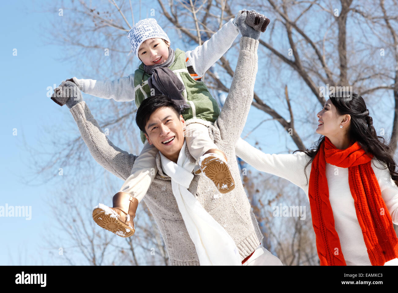 Father carrying the son and mother in the outdoor - Stock Image