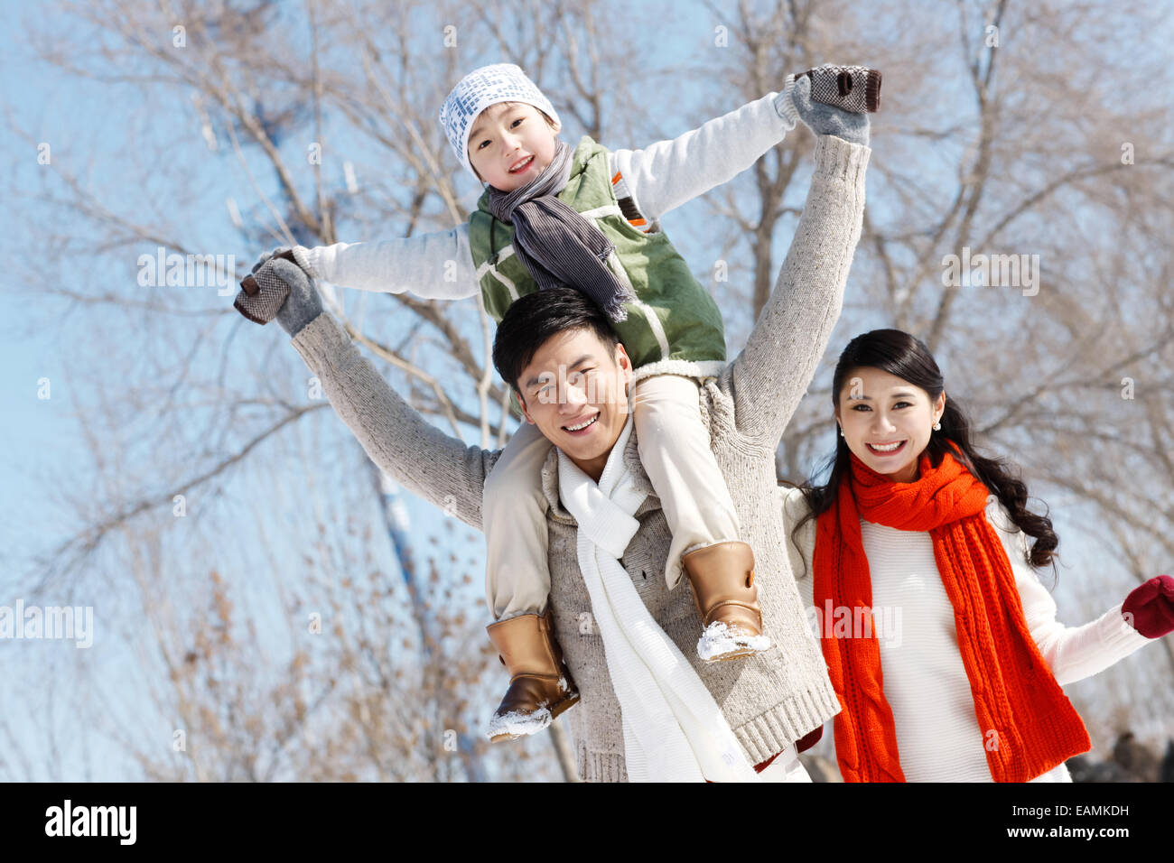 One-child families play outdoors - Stock Image