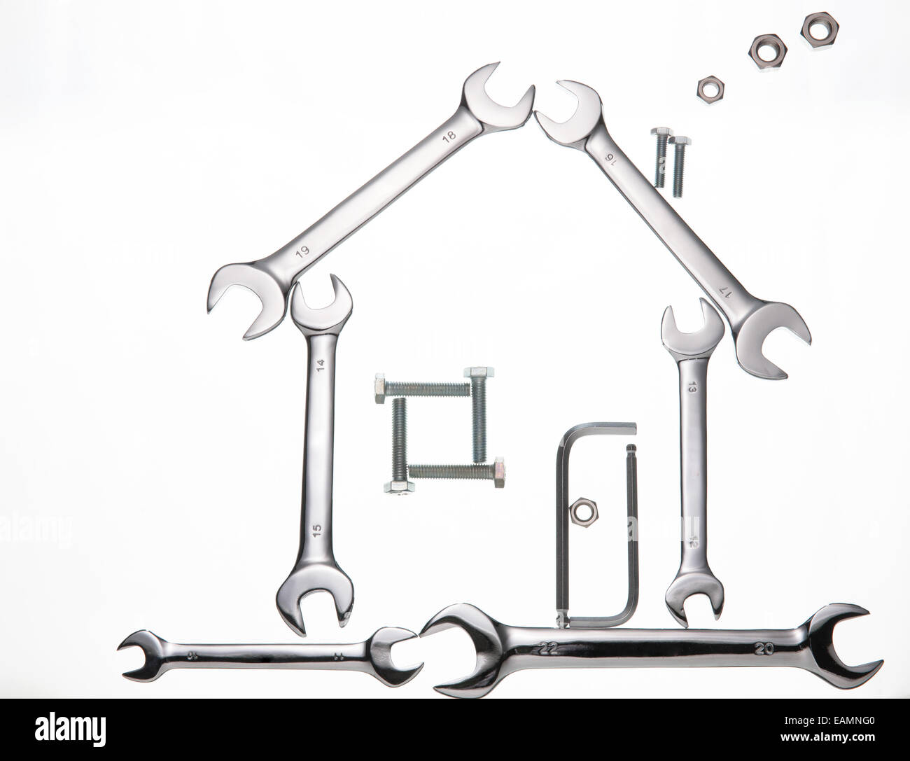 Using a wrench to construct houses - Stock Image