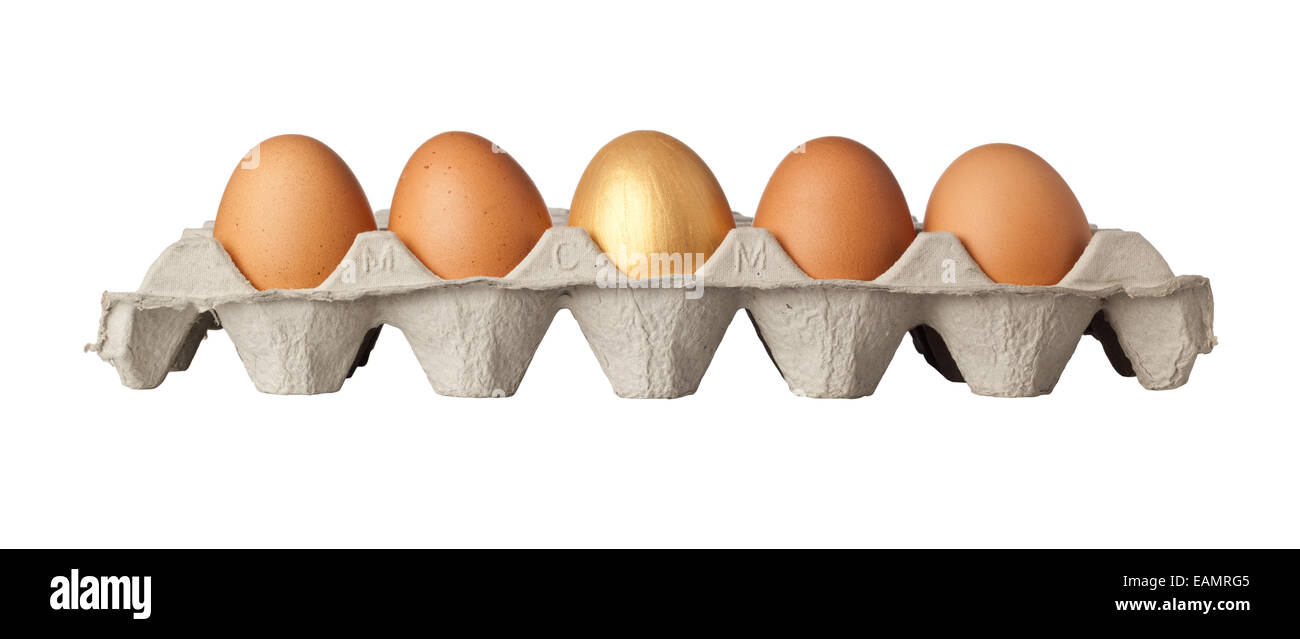 One golden egg in the middle of a tray of eggs isolated on white background - Stock Image