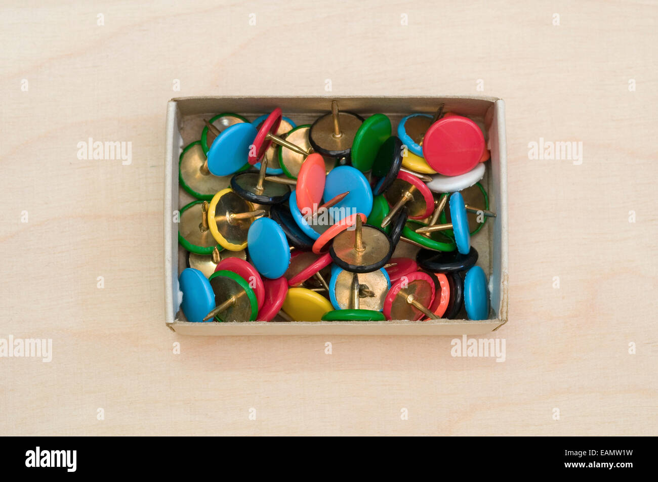 Push Pins in Paper Box - Stock Image