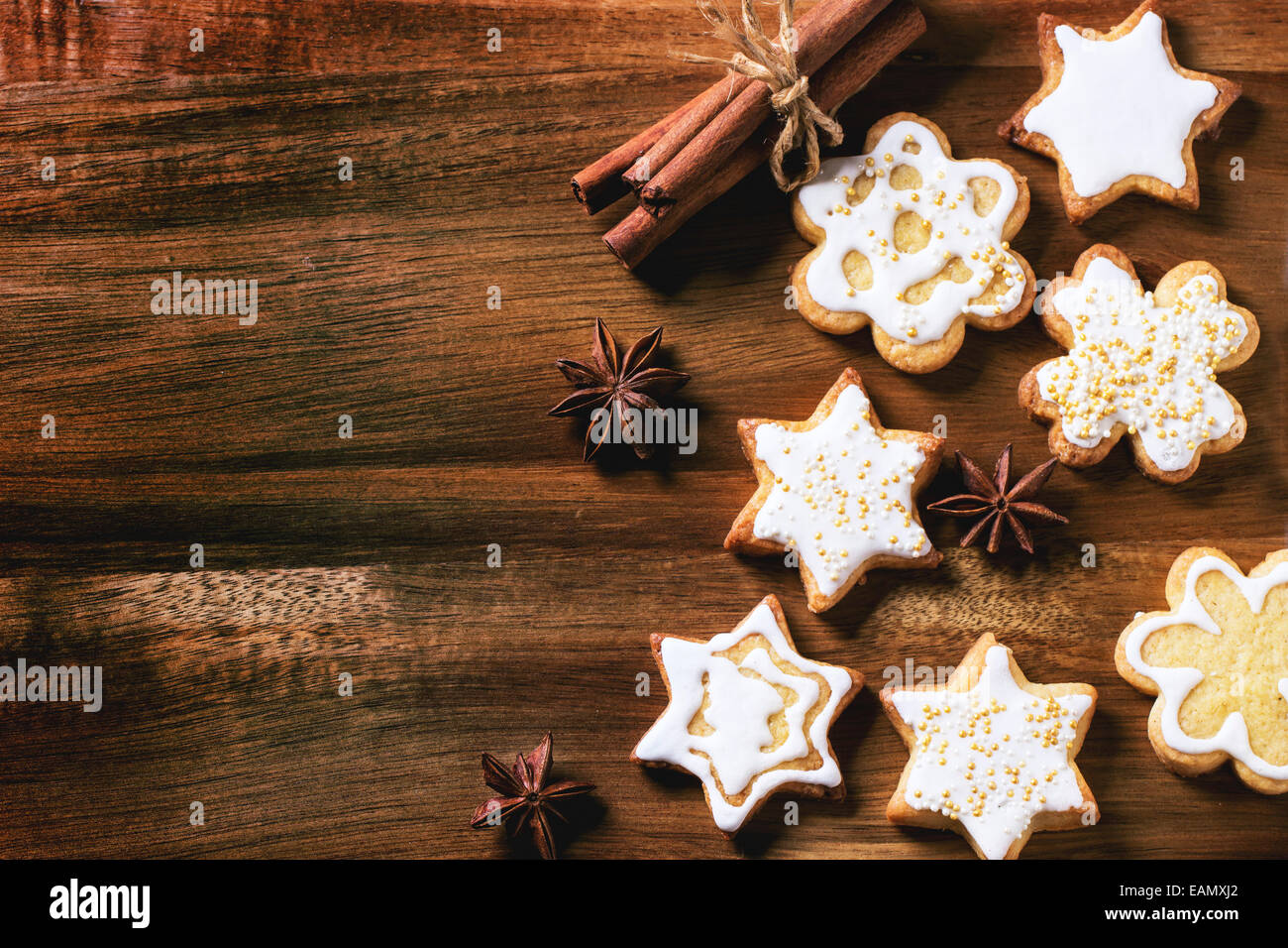 Christmas Cookies With Anise Stars And Cinnamon Sticks Over Wooden