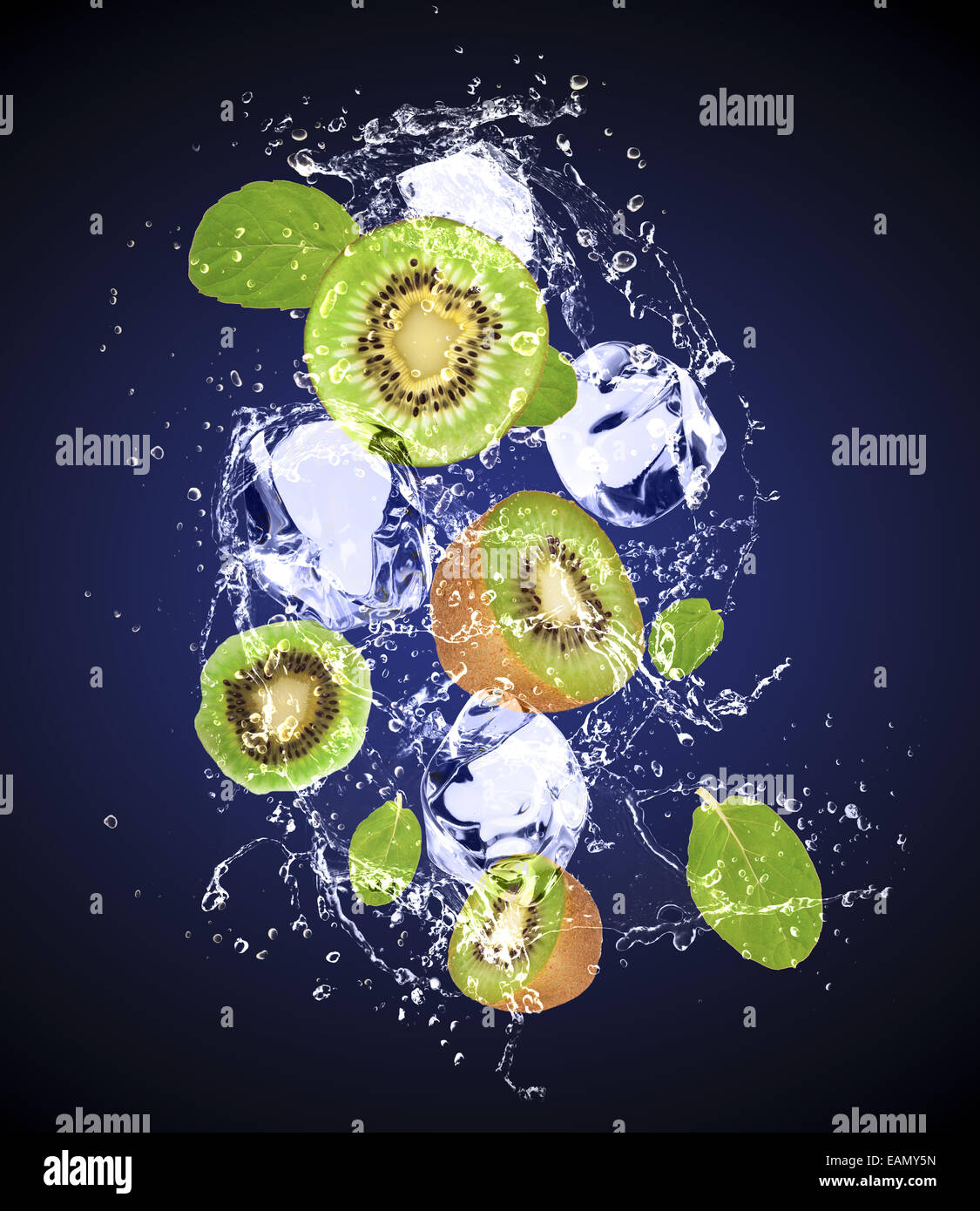 Isolated shot of fresh kiwi with ice and water - Stock Image
