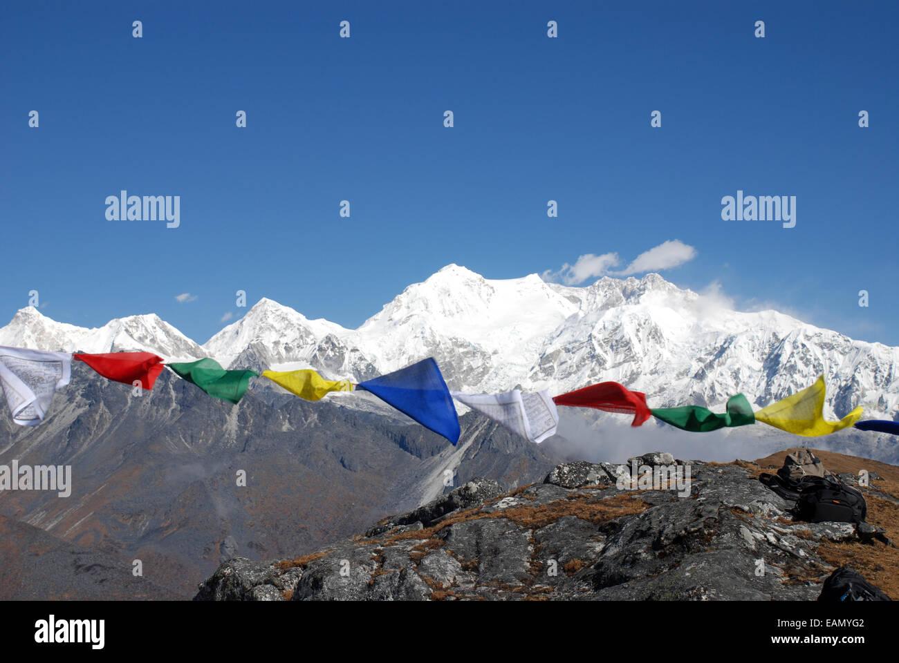 The Himalayan mountain of Kangchenjunga is framed by Buddhist prayer ...