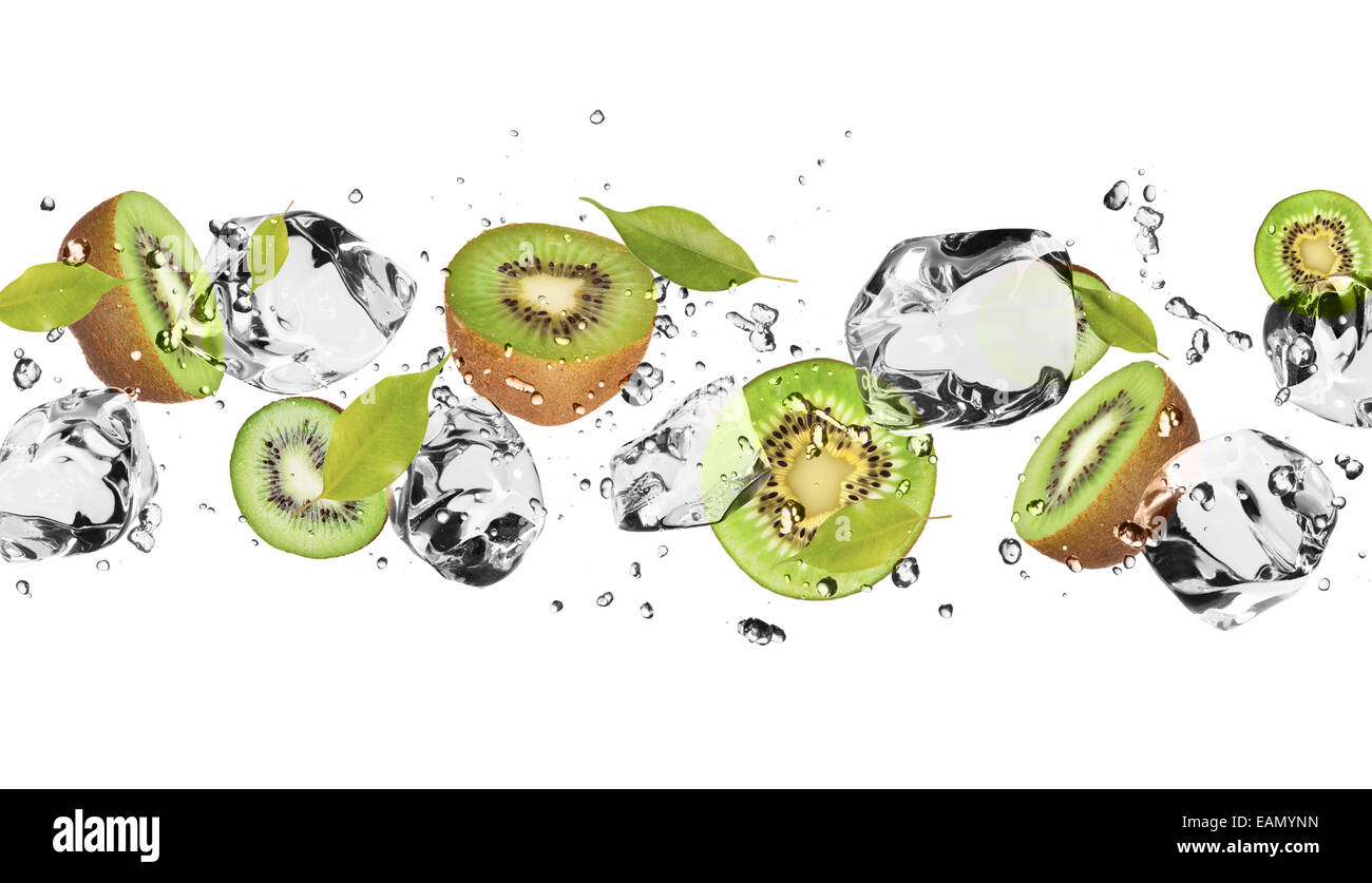 Pieces of kiwi with ice cubes, isolated on white background - Stock Image