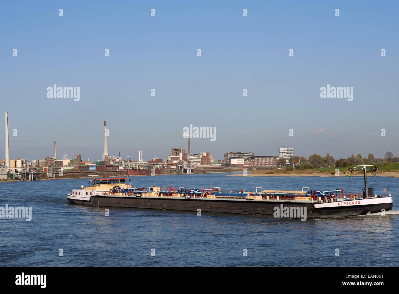 Oil tanker Neptunus sailing on the river Rhine, Krefeld, Germany. - Stock Image