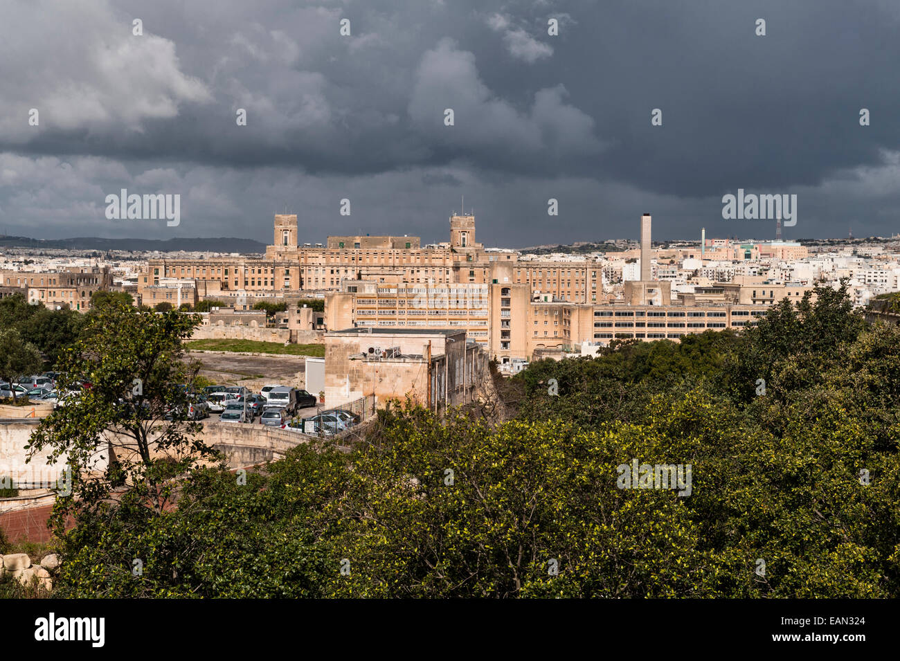 View over Valletta from the Argotti Botanical Gardens, Malta. An old military barracks - Stock Image
