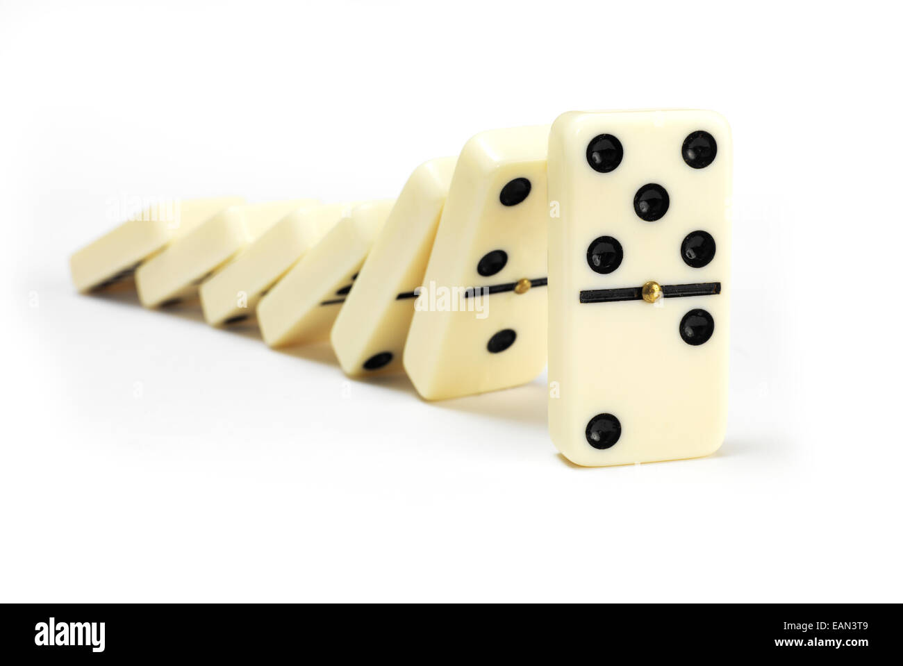 Line of Dominoes on white - Stock Image
