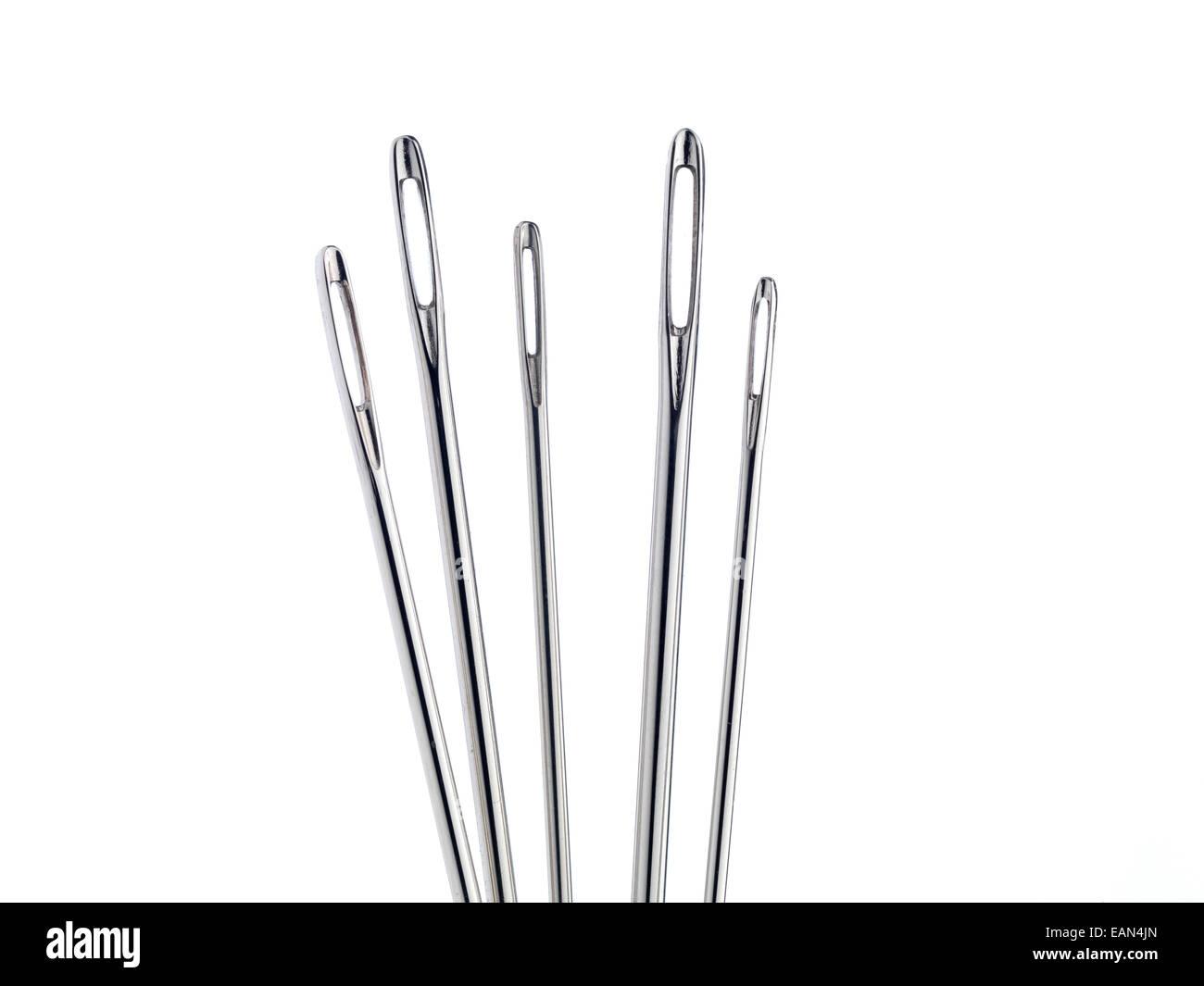 Needles on white background - Stock Image