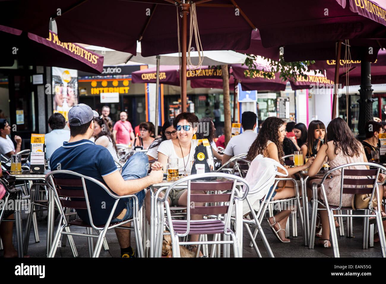 People Relaxing In A Bar Terrace In Madrid Spain Stock