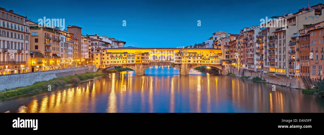 Florence. Panoramic image of historical center of Florence with Ponte Vecchio during twilight blue hour. - Stock Image