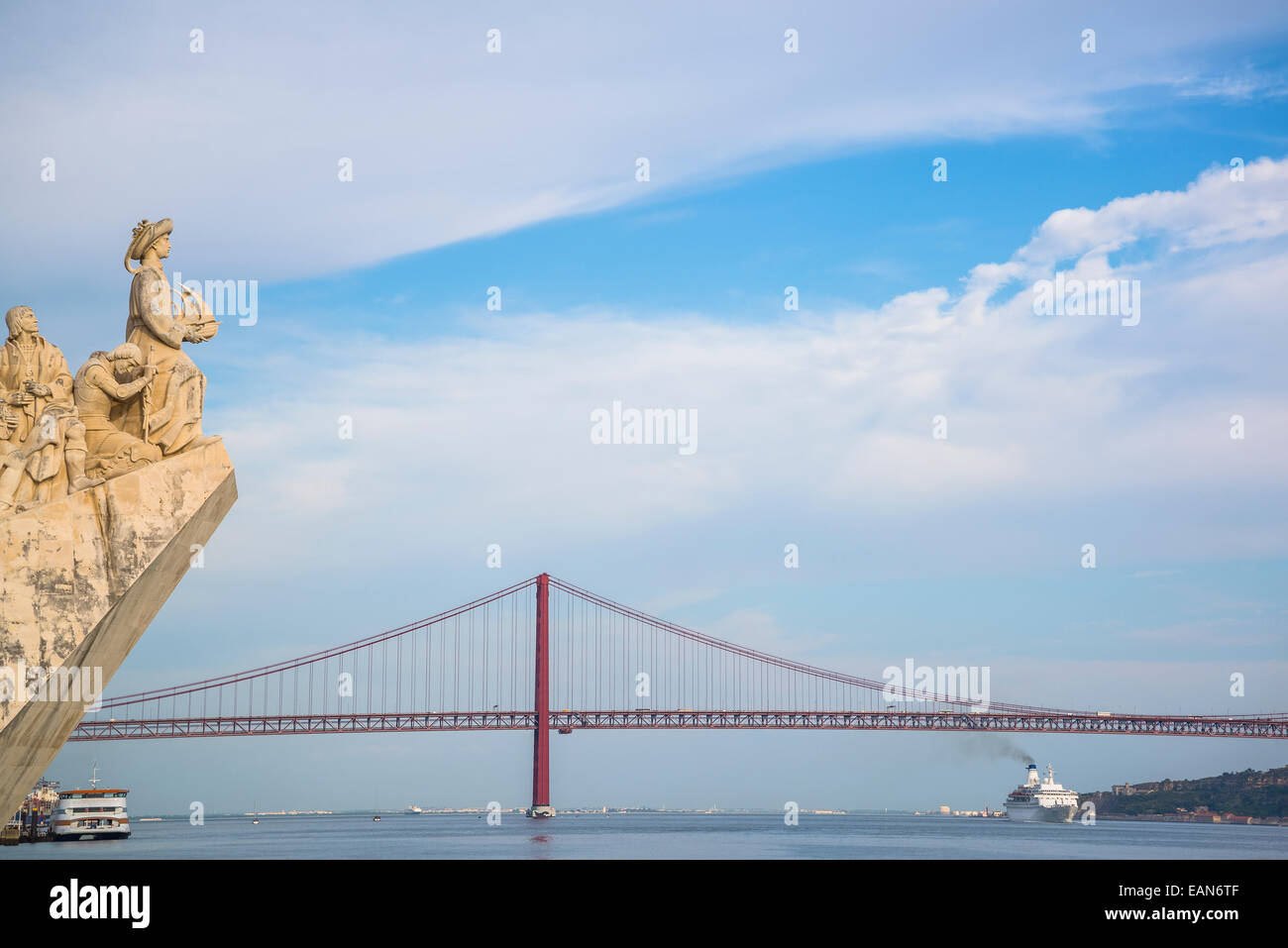 Monument to the Discoveries and  25th of April Bridge, Lisbon, Portugal - Stock Image