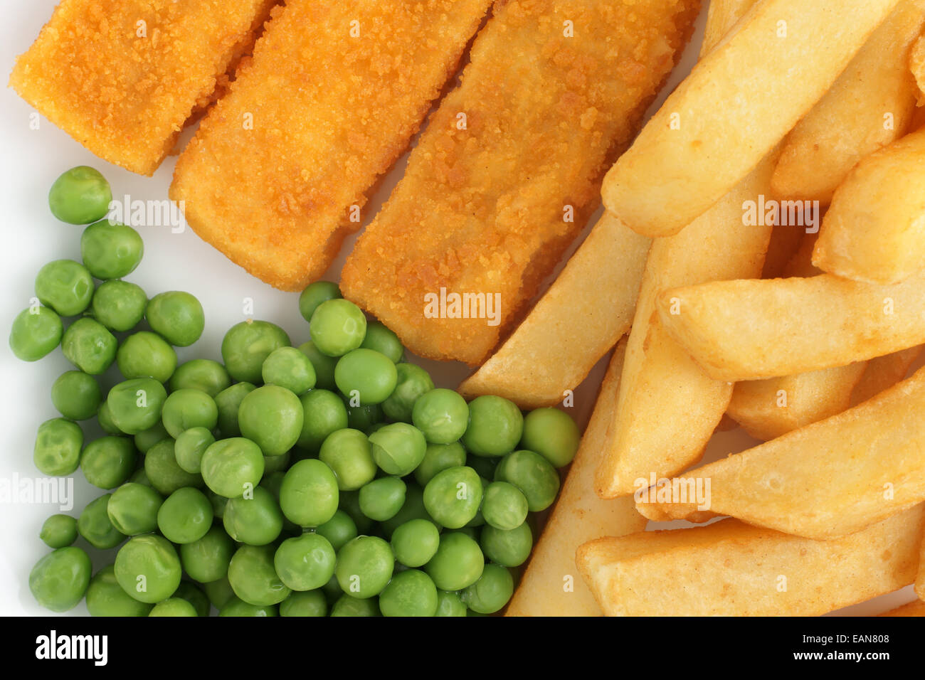 Fish fingers chips and peas a popular children's menu item - Stock Image