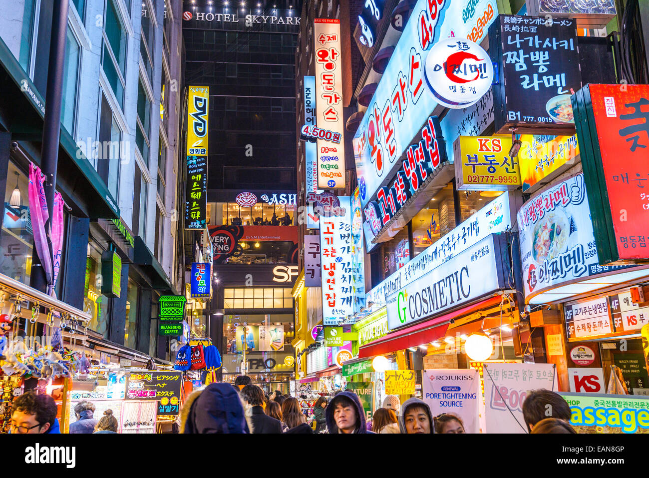 Myeong-Dong district at night in Seoul. The location is the premiere district for shopping in the city. - Stock Image