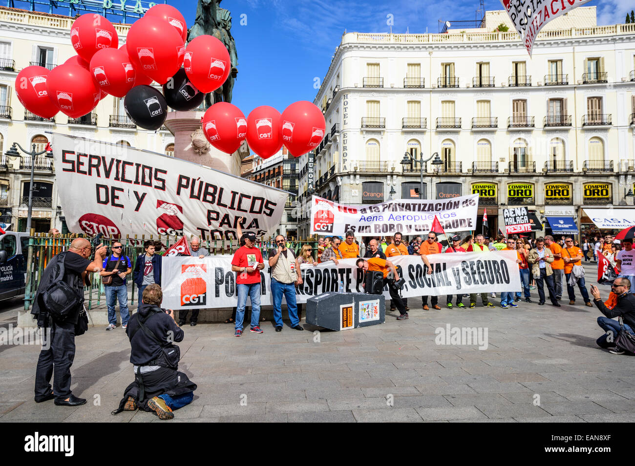 Crowds at Puerta del Sol Plaza protest the privatization of state-owned airport operator Aena Aeropuertos. - Stock Image
