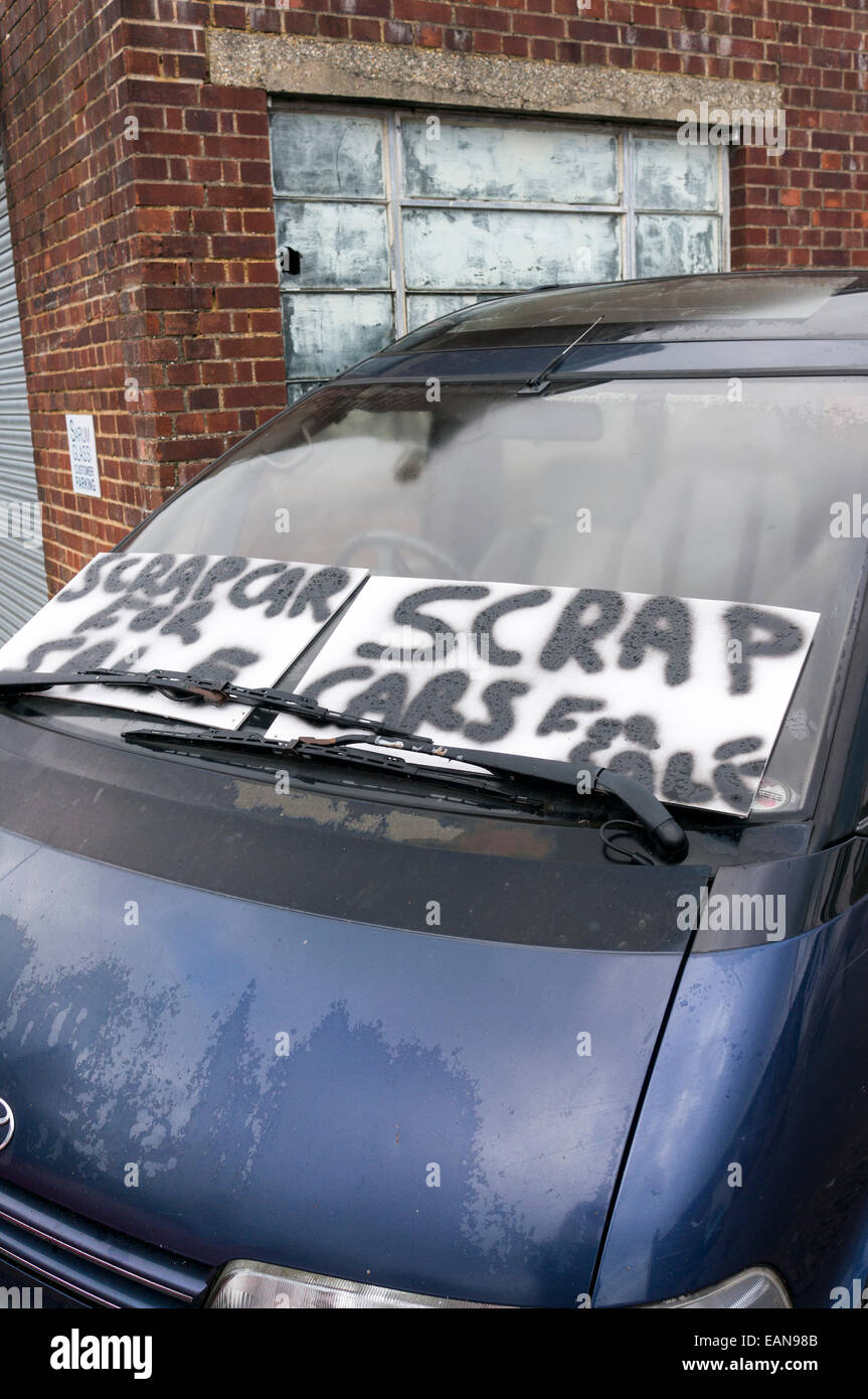 Scrap cars for sale sign on the windscreen of car Stock Photo ...