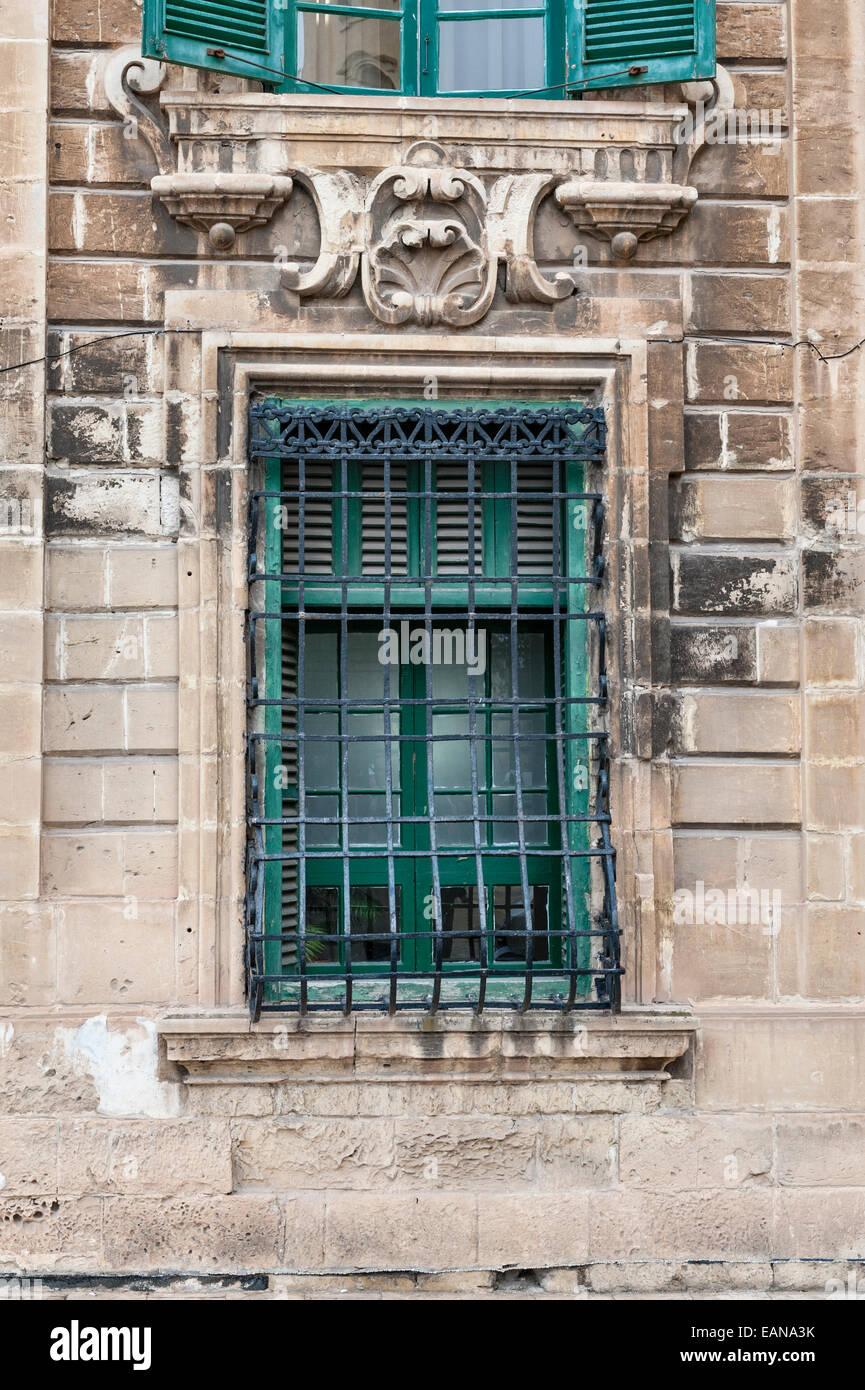 Valletta, Malta. Barred window on an old house - Stock Image