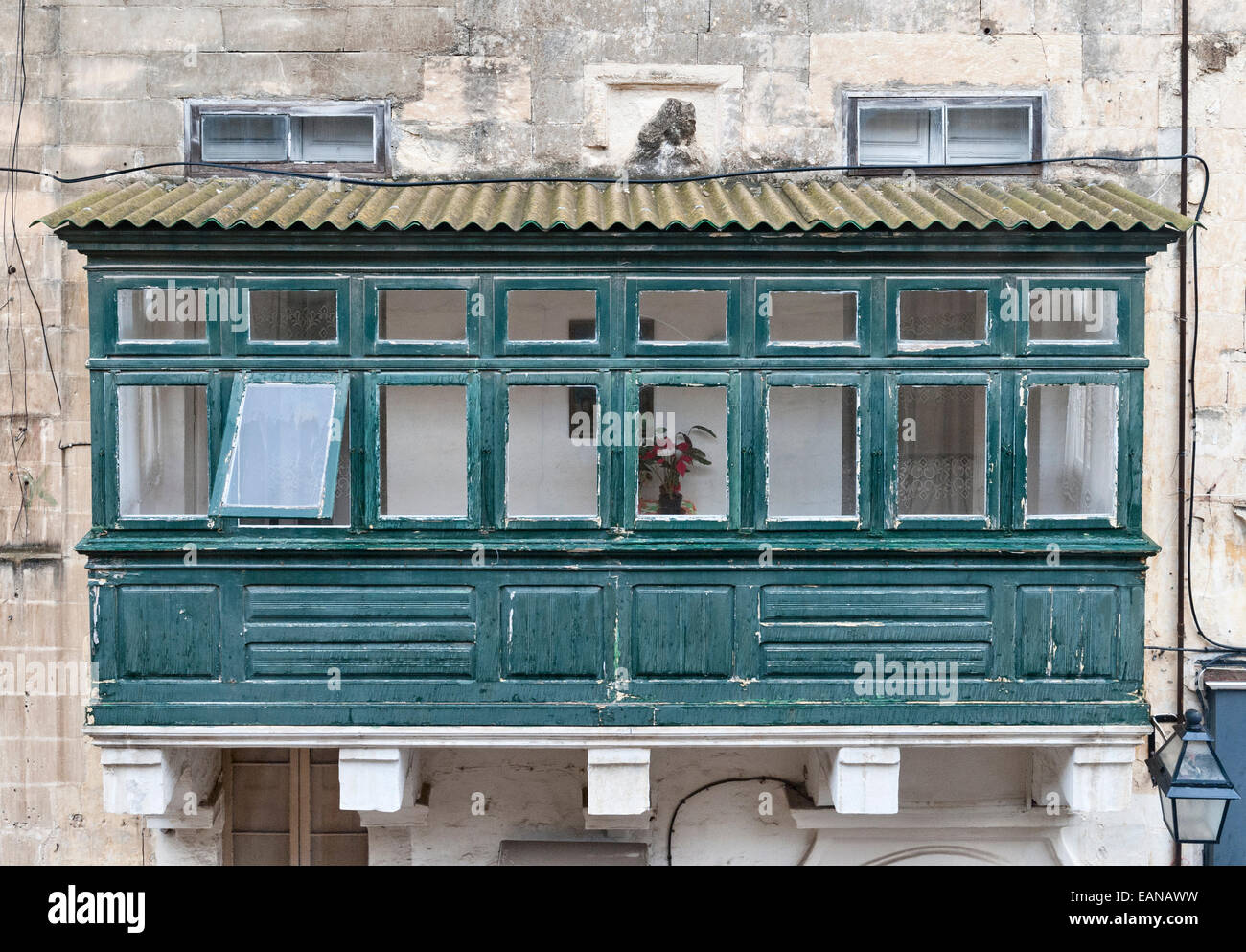 Valletta, Malta. A traditional enclosed wooden balcony (gallarija) on an old house - Stock Image
