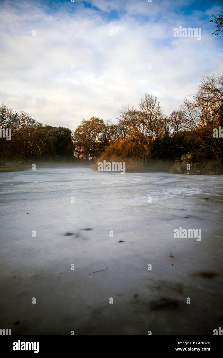 misty frosty morning on lake in winter Stock Photo