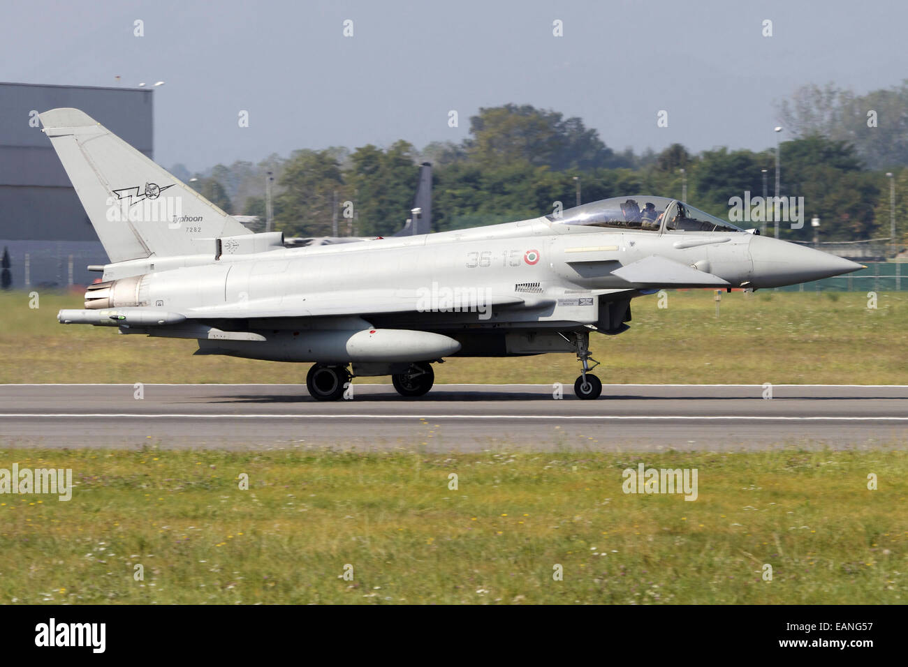 A Eurofighter Typhoon 2000 of the Italian Air Force taxiing on the runway at Turin Airport, Italy. - Stock Image